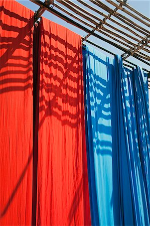 Freshly dyed fabric hanging to dry, Sari garment factory, Rajasthan, India, Asia Stock Photo - Rights-Managed, Code: 841-06031280