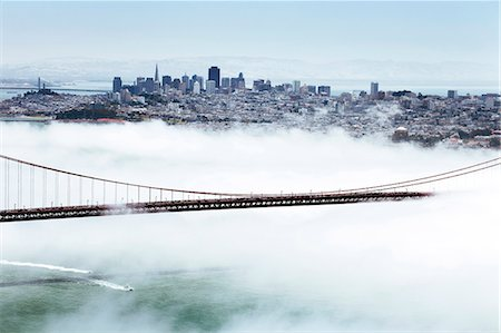 fog (weather) - Golden Gate Bridge and the San Francisco skyline floating above the fog on a foggy day in San Francisco, California, United States of America, North America Stock Photo - Rights-Managed, Code: 841-06031317