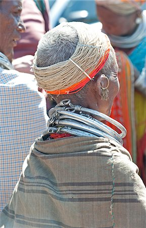 Bonda tribeswoman wearing shawl over traditional bead costume, with beaded cap and metal necklaces at weekly market, Rayagader, Orissa, India, Asia Stock Photo - Rights-Managed, Code: 841-06031744