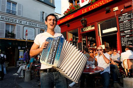 street cafe day - Busker in Montmartre, Paris, France, Europe Stock Photo - Rights-Managed, Code: 841-06032216