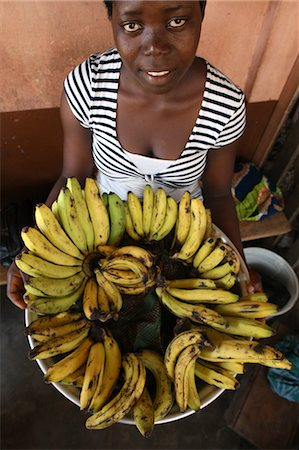 Girl selling bananas, Lome, Togo, West Africa, Africa Stock Photo - Rights-Managed, Code: 841-06032409