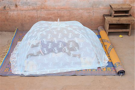Baby sleeping under a mosquito net, Lome, Togo, West Africa, Africa Stock Photo - Rights-Managed, Code: 841-06032442