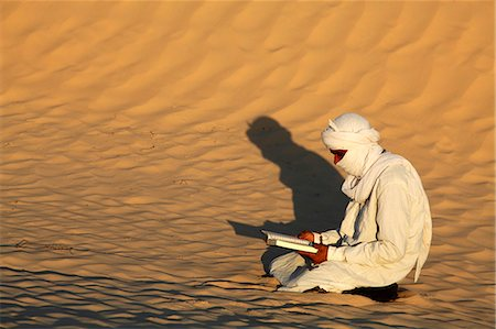 Beduin reading the Koran in the Sahara, Douz, Kebili, Tunisia, North Africa, Africa Stock Photo - Rights-Managed, Code: 841-06032466