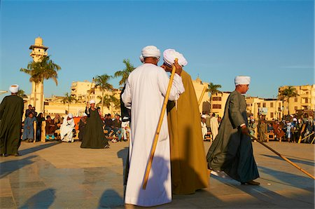 Tahtib demonstration, traditional form of Egyptian folk dance involving a wooden stick, also known as stick dance or cane dance, Mosque of Abu el-Haggag, Luxor, Egypt, North Africa, Africa Stock Photo - Rights-Managed, Code: 841-06032865