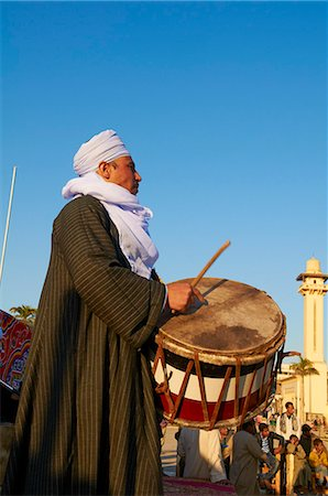 Drummer at Tahtib demonstration, a traditional form of Egyptian folk dance involving a wooden stick, also known as stick dance or cane dance, Mosque of Abu el-Haggag, Luxor, Egypt, North Africa, Africa Stock Photo - Rights-Managed, Code: 841-06032866