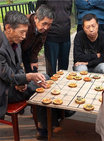 Men playing Chinese chess, Beijing, China, Asia Stock Photo - Rights-Managed, Code: 841-06033098