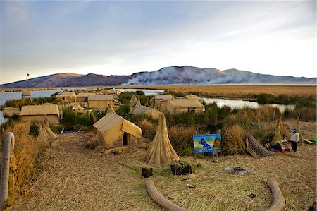 peru and culture - Floating islands of the Uros people, traditional reed boats and reed houses, Lake Titicaca, peru, peruvian, south america, south american, latin america, latin american South America Stock Photo - Rights-Managed, Code: 841-06345457