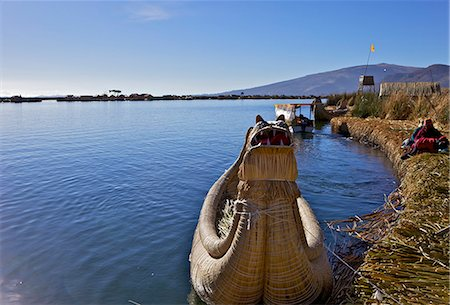 peru and culture - Floating islands of the Uros people, traditional reed boats and reed houses, Lake Titicaca, peru, peruvian, south america, south american, latin america, latin american South America Stock Photo - Rights-Managed, Code: 841-06345458