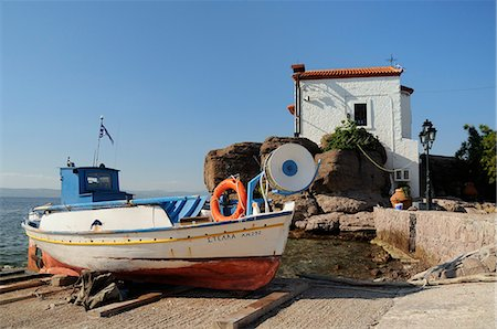 Fishing boat Stella on ramp near small chapel at Skala Sikaminia, Lesbos (Lesvos), Greek Islands, Greece, Europe Stock Photo - Rights-Managed, Code: 841-06345511