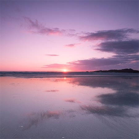 purple - Sunset reflected in wet sand and sea on Crackington Haven Beach, Cornwall, England, United Kingdom, Europe Stock Photo - Rights-Managed, Code: 841-06340841