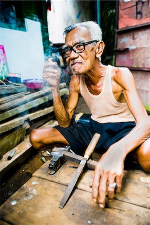 slim - Portrait of an Indonesian carpenter man at Taman Sari, Water Castle, Yogyakarta, Central Java, Indonesia, Southeast Asia, Asia Stock Photo - Rights-Managed, Code: 841-06341105