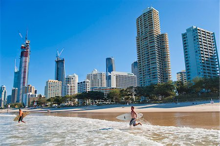 queensland - Surfers heading out to surf at Surfers Paradise beach, the Gold Coast, Queensland, Australia, Pacific Stock Photo - Rights-Managed, Code: 841-06341109