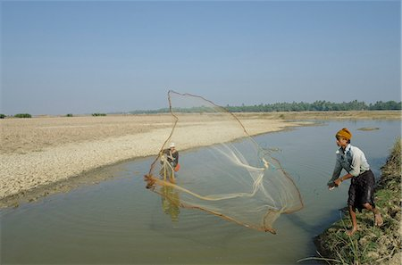 Youngster fishing with fishing net in a waterway, Irrawaddy delta, Myanmar (Burma), Asia Stock Photo - Rights-Managed, Code: 841-06341800