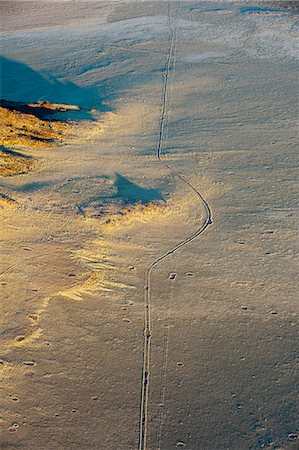 road landscape - Aerial view of road in the desert and fairy circles, Namib Naukluft Park, Namib Desert, Namibia, Africa Stock Photo - Rights-Managed, Code: 841-06342180