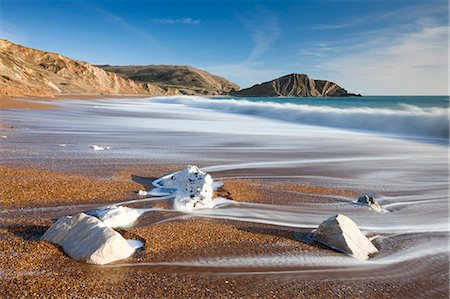 Waves wash clean the beautiful beach at Worbarrow Bay on the Jurassic Coast, UNESCO World Heritage Site, Dorset, England, United Kingdom, Europe Stock Photo - Rights-Managed, Code: 841-06343581