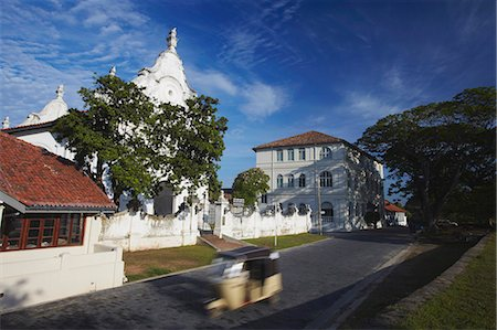 Tuk tuk passing Dutch Reformed Church, Galle, Southern Province, Sri Lanka, Asia Stock Photo - Rights-Managed, Code: 841-06343773