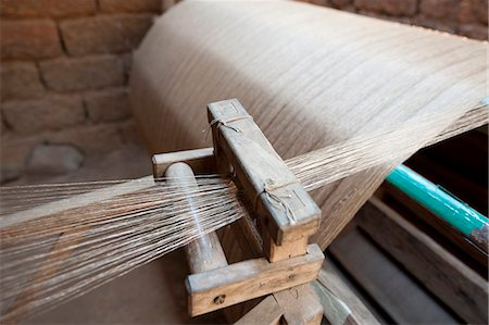 silk - Silk thread being spun on large handmade wooden wheel, rural Orissa, India, Asia Stock Photo - Rights-Managed, Code: 841-06343925