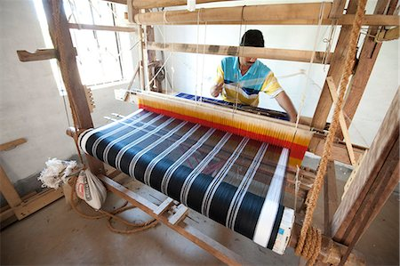 silk - Man weaving coloured silk sari on domestic loom, rural Orissa, India, Asia Stock Photo - Rights-Managed, Code: 841-06343926