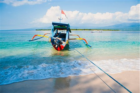 simsearch:400-04638538,k - Gili Meno, a traditional Indonesian boat on Gili Meno with Gili Air and Lombok in the background, Gili Islands, Indonesia, Southeast Asia, Asia Stock Photo - Rights-Managed, Code: 841-06445073