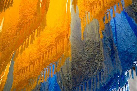dyed - Brightly coloured dyed fabrics hanging to dry in the dyers souk, Marrakech, Morocco, North Africa, Africa Stock Photo - Rights-Managed, Code: 841-06445528