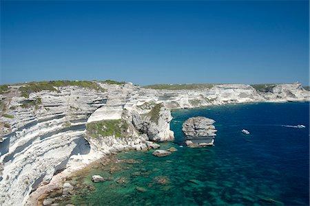 White limestone cliffs above emerald sea in Bonifacio, Corsica, France, Mediterranean, Europe Stock Photo - Rights-Managed, Code: 841-06445565