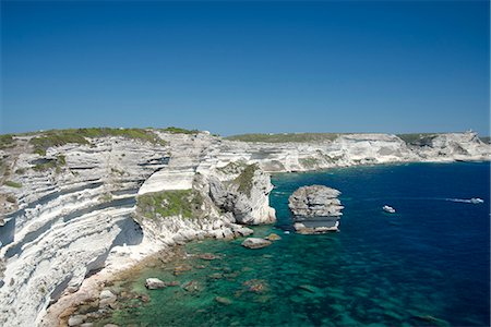 White limestone cliffs above emerald sea in Bonifacio, Corsica, France, Mediterranean, Europe Stock Photo - Rights-Managed, Code: 841-06445565