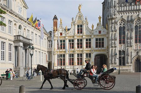 A horse drawn carriage crosses the Burg Square, passing the Stadhuis (Town Hall) buildings, Brugge, Belgium, Europe Stock Photo - Rights-Managed, Code: 841-06446256