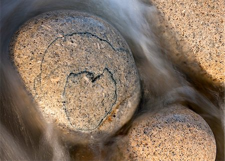smooth - Heart shaped pattern on a circular granite boulder, Porth Nanven, Cornwall, England, United Kingdom, Europe Stock Photo - Rights-Managed, Code: 841-06447538