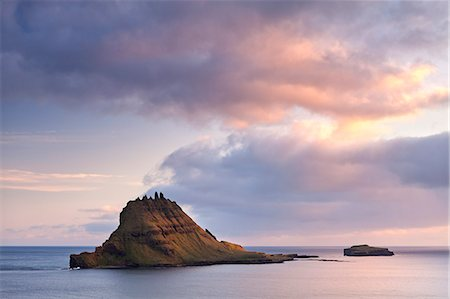 The islet of Tindholmur at the mouth of Sorvagsfjordur, Vagar Island, Faroes Islands, Denmark, Europe Stock Photo - Rights-Managed, Code: 841-06447566