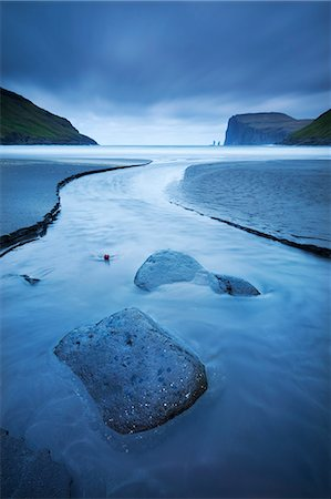 dreamy - A stream runs into the sea at Tjornuvik on the island of Streymoy in the Faroe Islands, Denmark, Europe Stock Photo - Rights-Managed, Code: 841-06447560