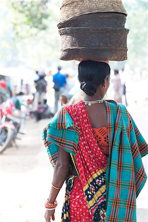 Woman at weekly tribal market wearing brightly coloured clothing and carrying baskets on her head, Bissam Cuttack, Orissa, India, Asia Stock Photo - Rights-Managed, Code: 841-06447664