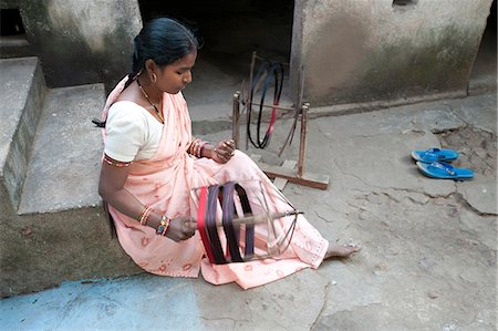 silk - Woman spinning silk thread by hand outside her house, Vaidyanathpur, Orissa, India, Asia Stock Photo - Rights-Managed, Code: 841-06447675