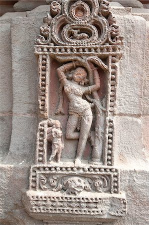 erotic female figures - Erotic carving of woman on the 11th century Rajarani temple, known as the love temple, dedicated to Lord Shiva, Bhubaneshwar, Orissa, India, Asia Stock Photo - Rights-Managed, Code: 841-06447791
