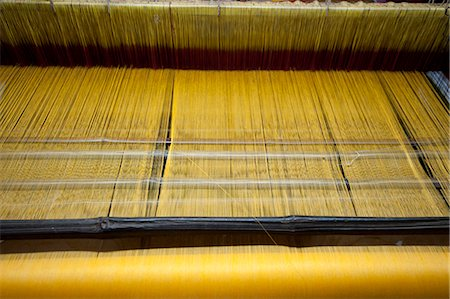silky - Yellow dyed silk being woven on loom, Naupatana weaving village, rural Orissa, India, Asia Stock Photo - Rights-Managed, Code: 841-06447815
