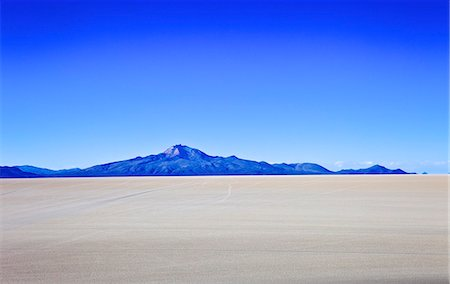 Salar de Uyuni salt flats and the Andes mountains in the distance, Bolivia, South America Stock Photo - Rights-Managed, Code: 841-06449715