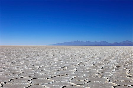 Details of the salt deposits in the Salar de Uyuni salt flat and the Andes mountains in the distance in south-western Bolivia, Bolivia, South America Stock Photo - Rights-Managed, Code: 841-06449731