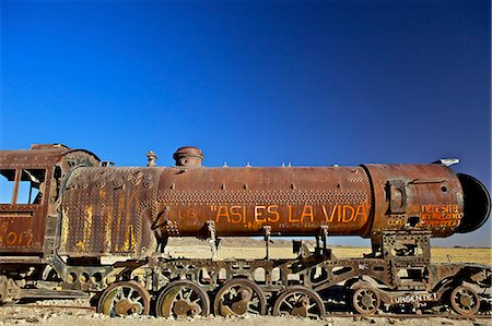 steam engine - Rusting old steam locomotive at the Train cemetery (train graveyard), Uyuni, Southwest, Bolivia, South America Stock Photo - Rights-Managed, Code: 841-06449769