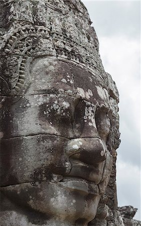 A smiling face carved in stone, Bayon, Angkor, UNESCO World Heritage Site, Siem Reap, Cambodia, Indochina, Southeast Asia, Asia Stock Photo - Rights-Managed, Code: 841-06499223