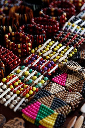 Crafts for sale at the souvenir shop of the Pataxo Indian people at the Reserva Indigena da Jaqueira near Porto Seguro, Bahia, Brazil, South America Stock Photo - Rights-Managed, Code: 841-06500533