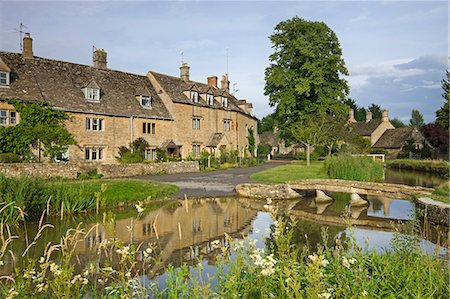 Cottages and footbridge over the River Eye in the Cotswolds village of Lower Slaughter, Gloucestershire, England, United Kingdom, Europe Stock Photo - Rights-Managed, Code: 841-06501313
