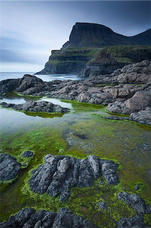Algae lined rockpools on the coast at Gasadalur on the island of Vagar, Faroe Islands, Denmark, Europe Stock Photo - Rights-Managed, Code: 841-06501331