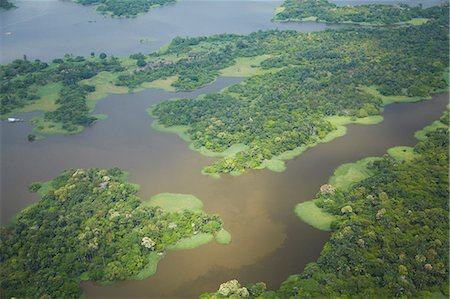 Aerial view of Amazon rainforest and tributary of the Rio Negro, Manaus, Amazonas, Brazil, South America Stock Photo - Rights-Managed, Code: 841-06501446