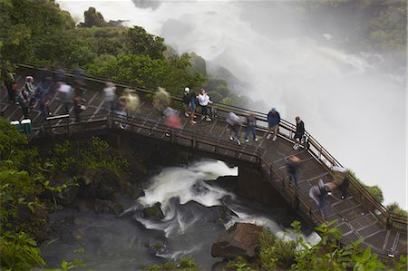 people in argentina - Tourists crossing bridge at foot of Bossetti Falls, Iguazu Falls, Iguazu National Park, UNESCO World Heritage Site, Misiones, Argentina, South America Stock Photo - Rights-Managed, Code: 841-06501835