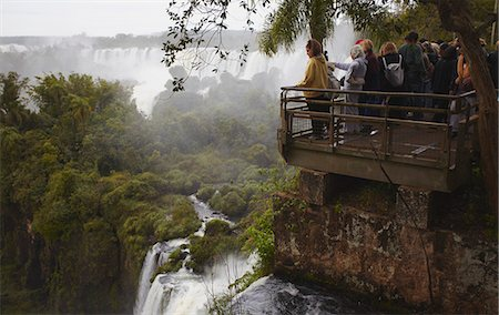 people in argentina - Tourists at Iguazu Falls, Iguazu National Park, UNESCO World Heritage Site, Misiones, Argentina, South America Stock Photo - Rights-Managed, Code: 841-06501832