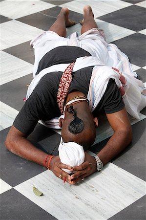 Hare Krishna devotee prostrating on the temple floor, Vrindavan, Uttar Pradesh, India, Asia Stock Photo - Rights-Managed, Code: 841-06502173