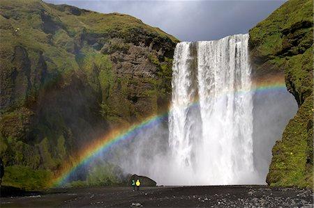 rainbow - Skogafoss waterfall with rainbow in summer sunshine, South coast, Iceland, Polar Regions Stock Photo - Rights-Managed, Code: 841-06502648