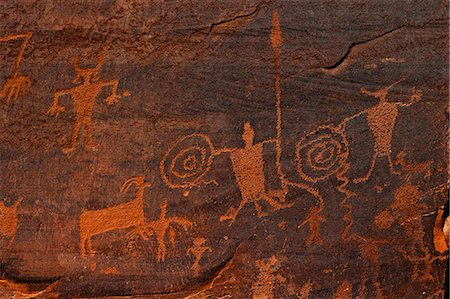 Horned anthropomorphs holding shields, Formative Period Petroglyphs, Utah Scenic Byway 279, Potash Road, Moab, Utah, United States of America, North America Stock Photo - Rights-Managed, Code: 841-06502750