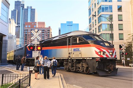 Metra Train passing pedestrians at an open railroad crossing, Downtown, Chicago, Illinois, United States of America, North America Stock Photo - Rights-Managed, Code: 841-06616700