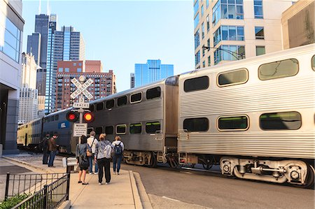 Metra Train passing pedestrians at an open railroad crossing, Downtown, Chicago, Illinois, United States of America, North America Stock Photo - Rights-Managed, Code: 841-06616701