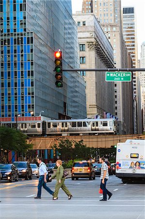 L train on elevated track crosses South LaSalle Street in the Loop district, Chicago, Illinois, United States of America, North America Stock Photo - Rights-Managed, Code: 841-06616727